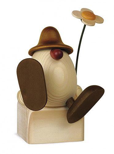 Eierkopf Alfons mit Blume sitzend tanzend, braun 11 cm